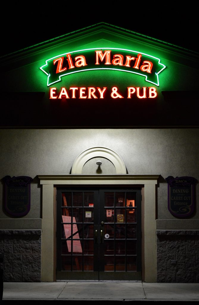 Front of Zia Maira Restaurant and Pub with Glowing Neon Sign