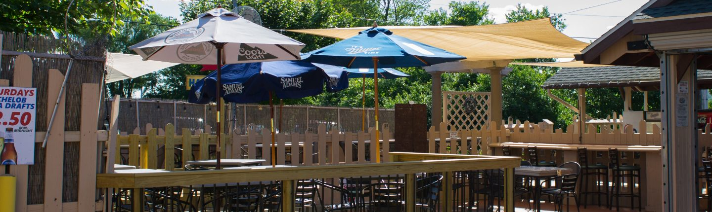 Outdoor Deck Seating with Tables with Umbrellas