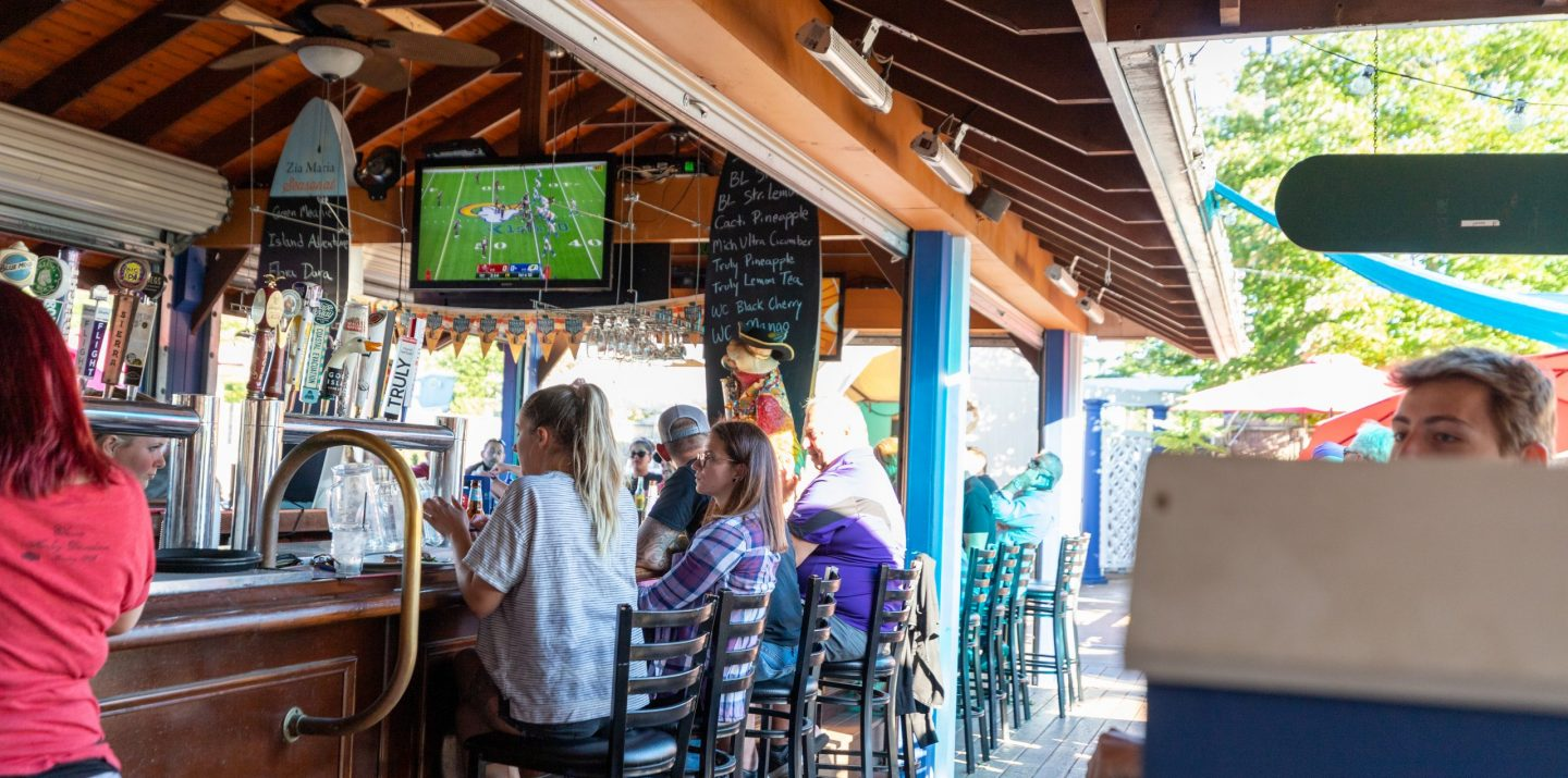 customers eating and drinking at the zia maria outdoor bar in lancaster pa while football is on tv